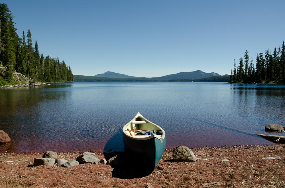 Canoe beached on volcanic gravel at Waldo Lake