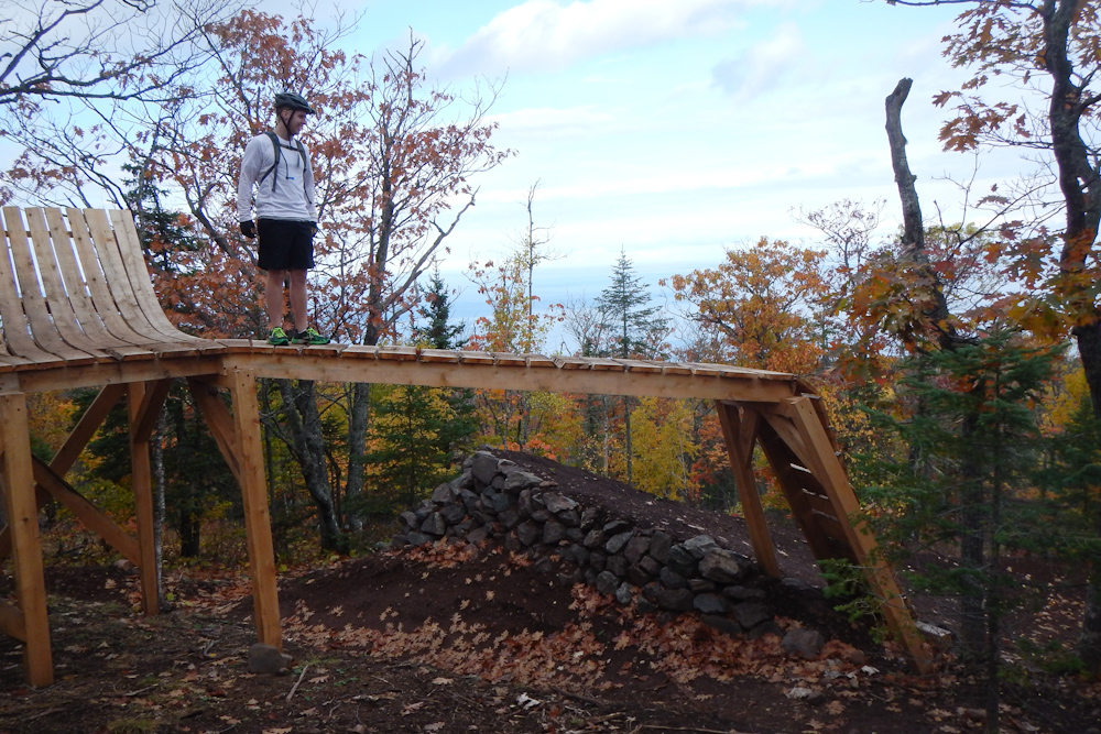 The wooden gap feature on the new Overflow downhill MTB trail at Copper Harbor