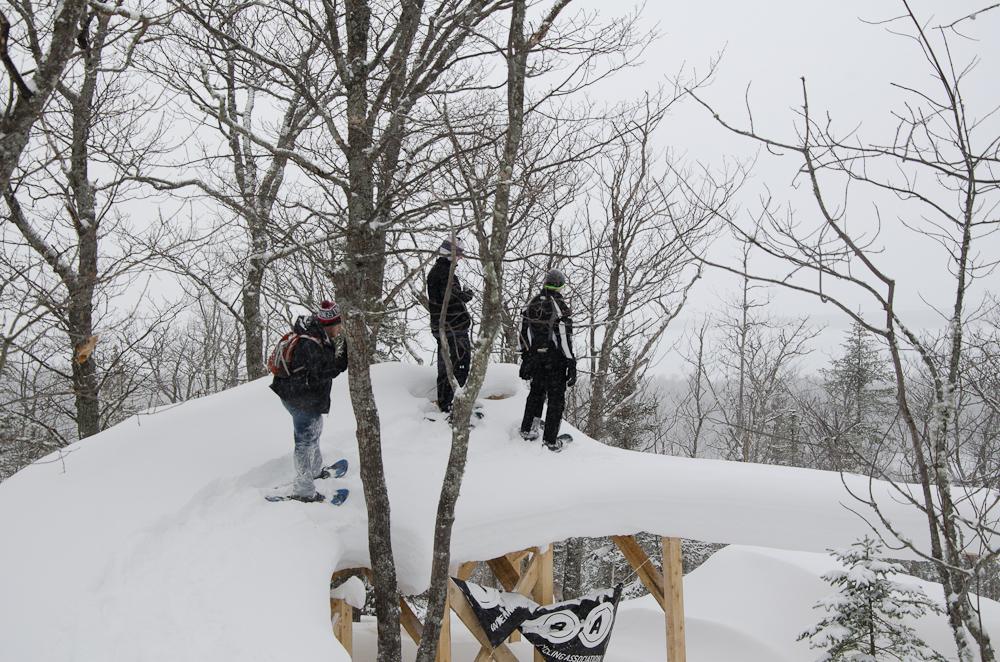 Overflow downhill mountain bike trail wooden feature in winter