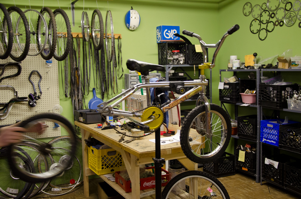 A kid's bike on one of the workstands